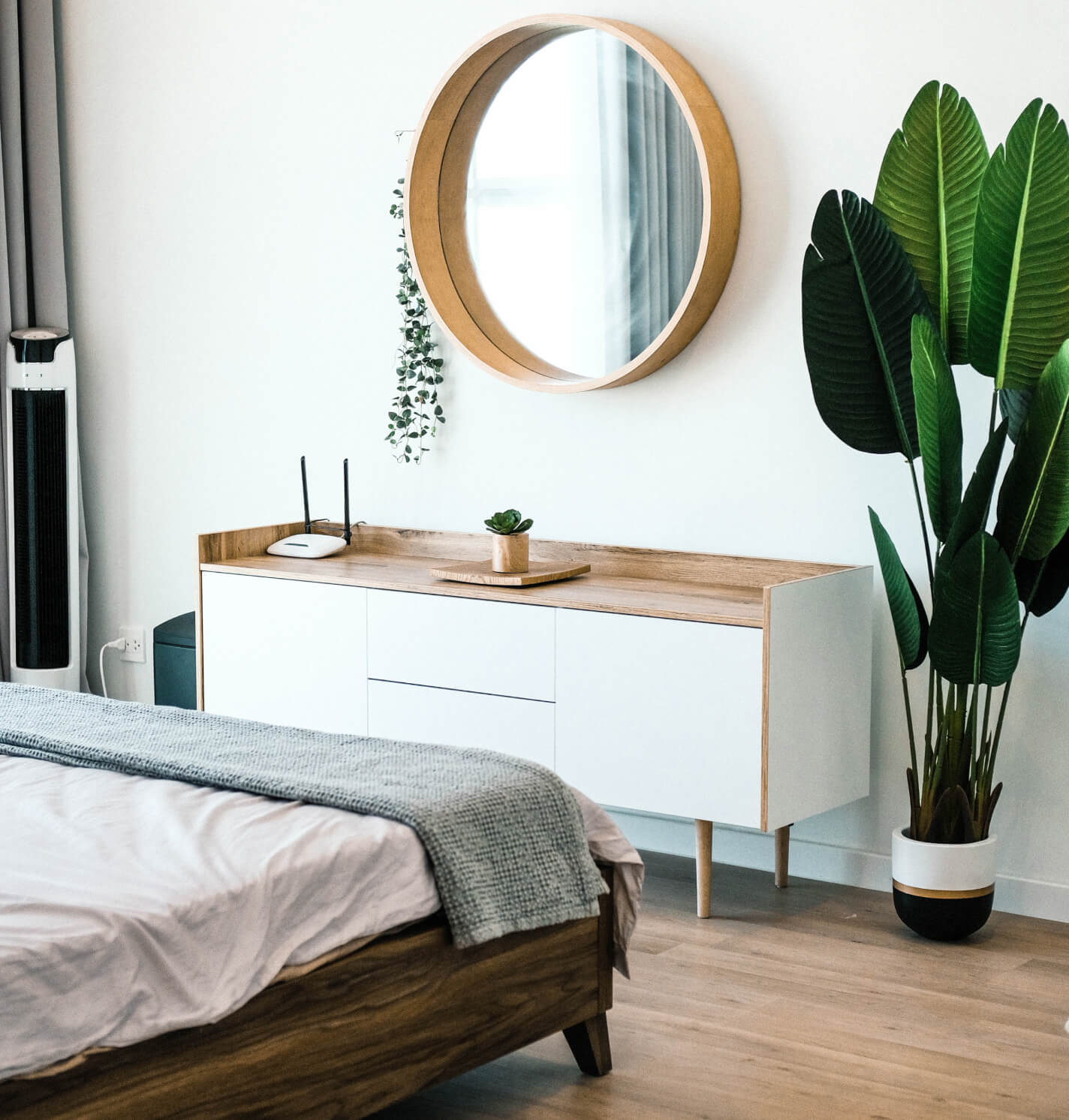 White Bedroom With Green Plant
